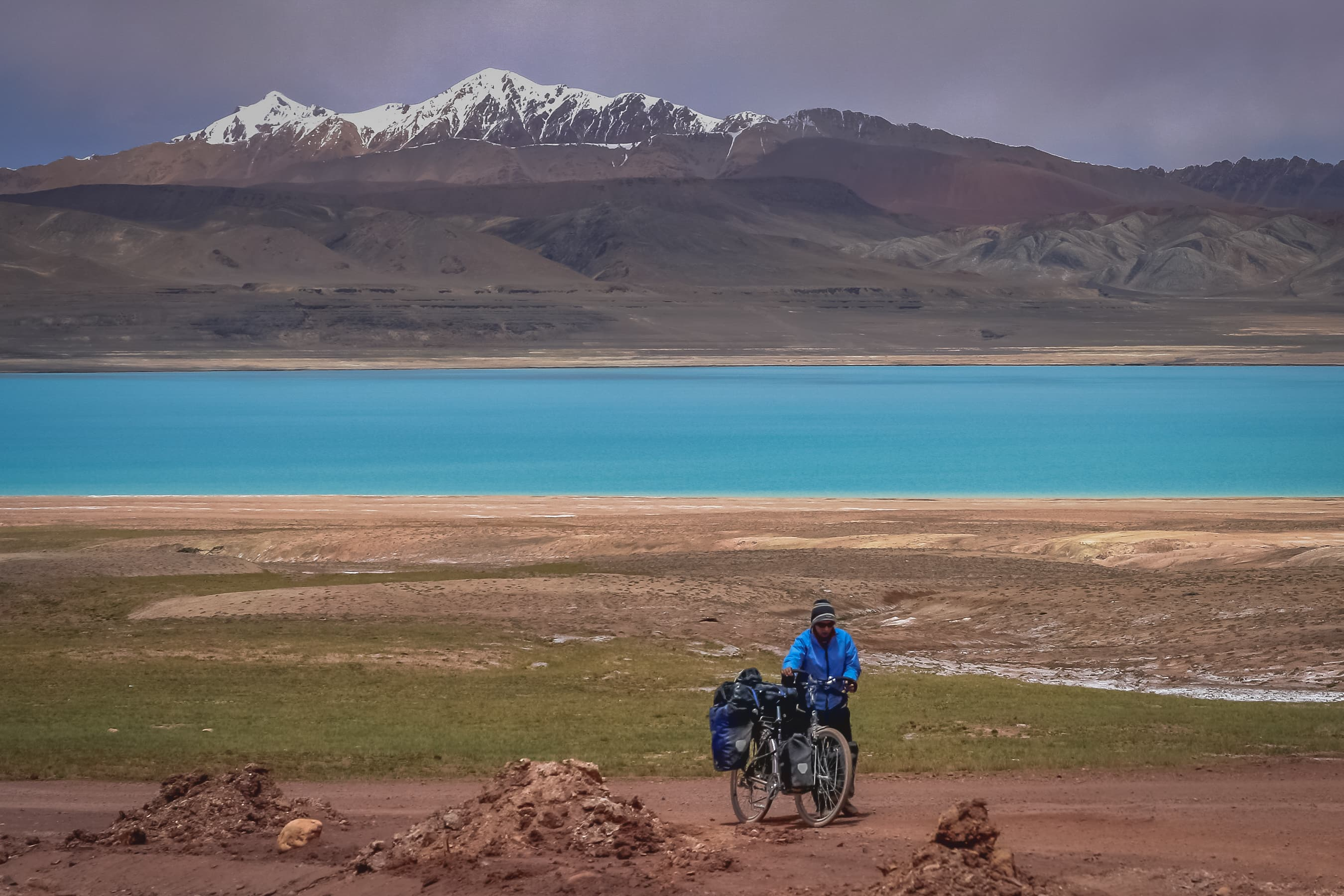 Traveling on bicycle on a mountain road, Tibetan plateau