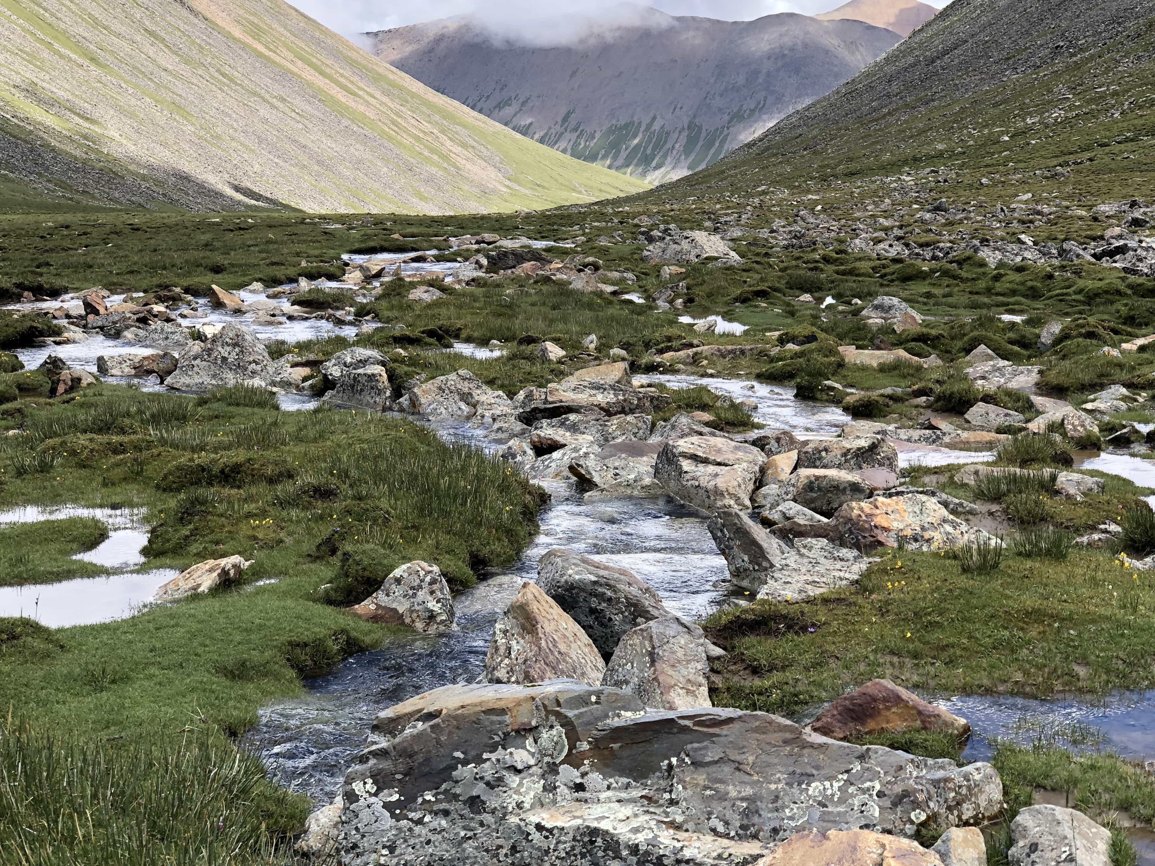 Mountain stream on the trekking route in Tibet