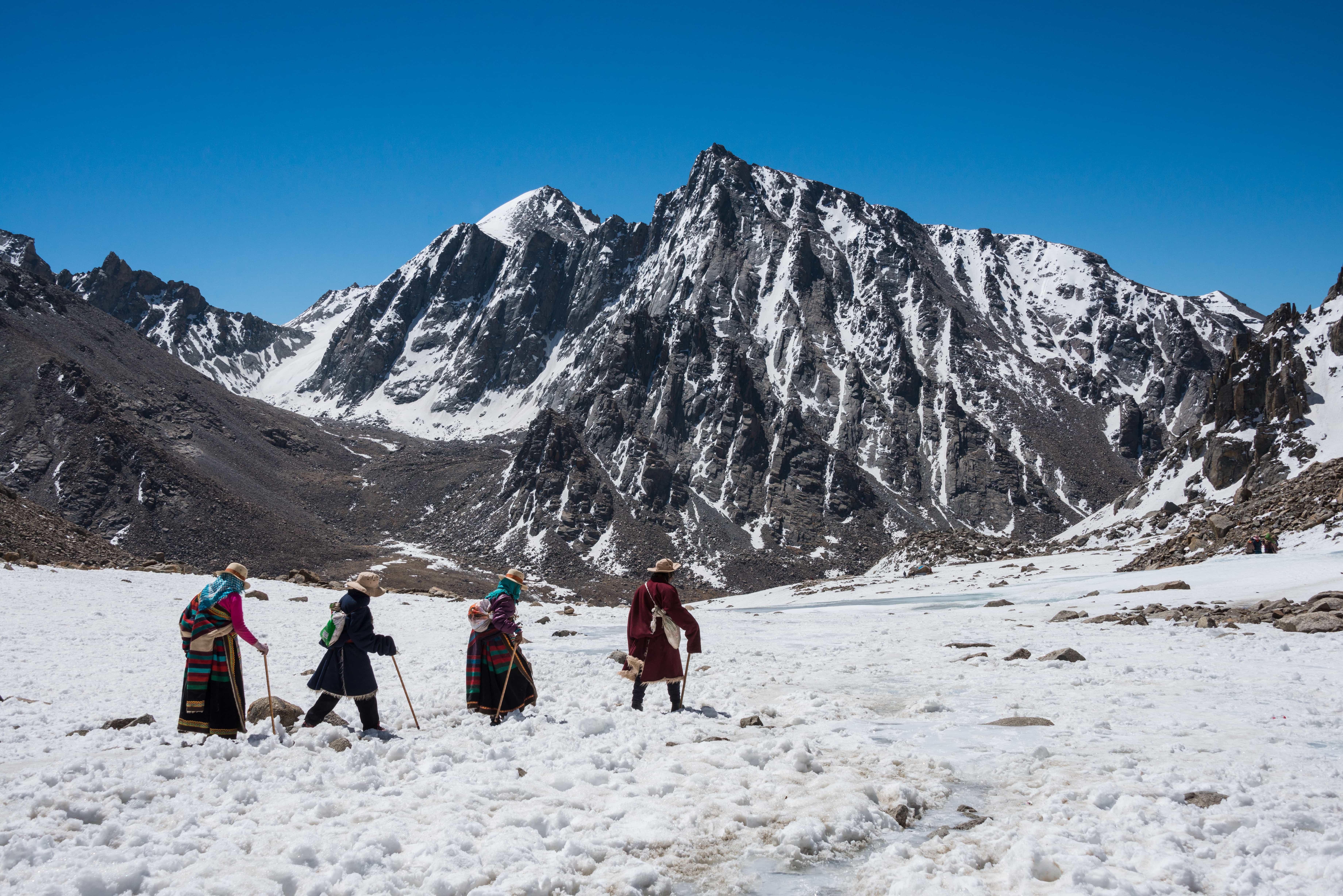 Tibetan Buddhist pilgrims walking the kora around Mount Kailash
