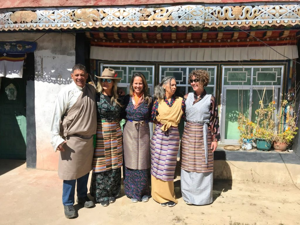 Tourists trying on traditional Tibetan clothes