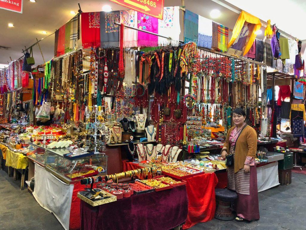 Tibetan seller in Barkhor supermarket