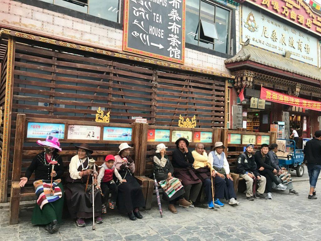 Tibetans sitting by the tea house on Barkhor street, Lhasa
