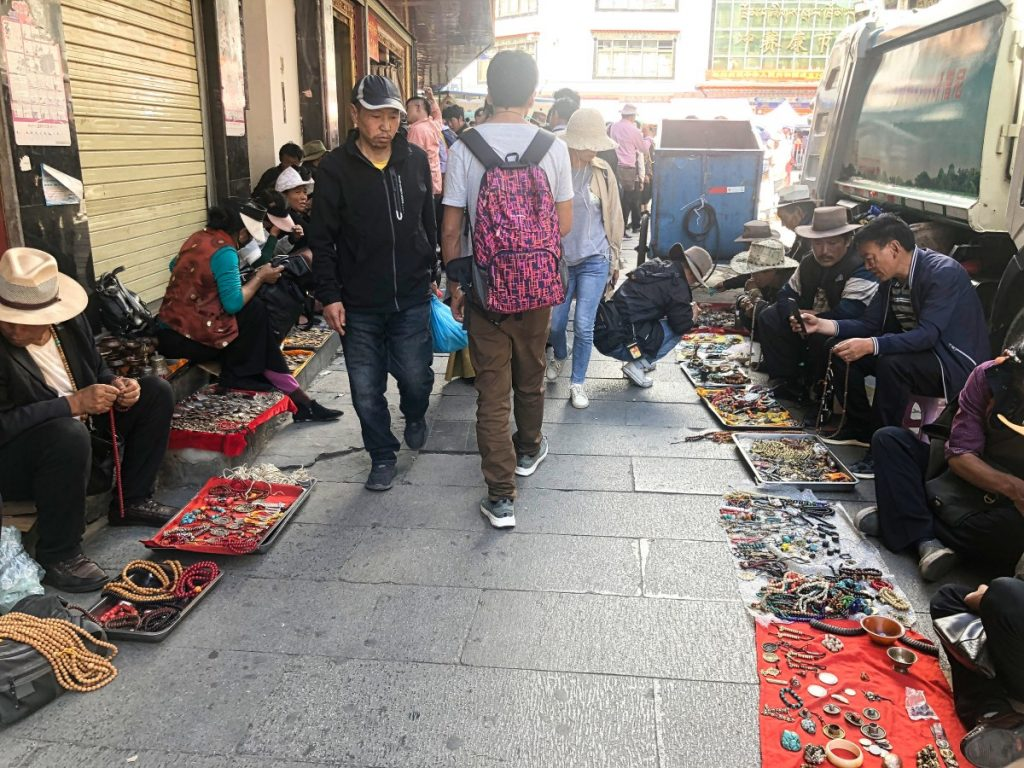 Sellers in Tromsikhang outdoor market in Lhasa Old Town