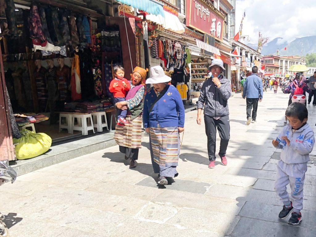 Tibatns walking in the Old Town in Lhasa